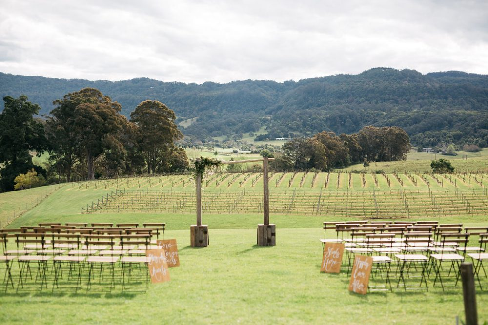 outdoor countryside wedding ceremony with wedding arbour