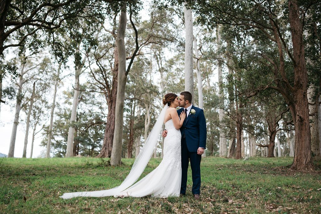 stylish luxury countryside wedding portraits of bride and groom in woodlands