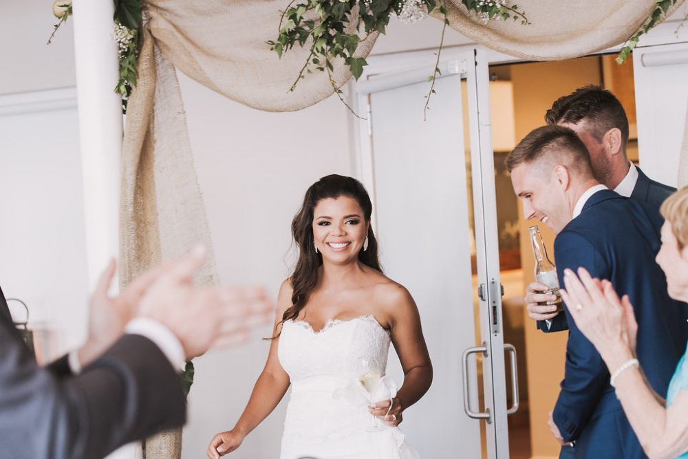 bride making her entrance to her stylish luxury wedding reception