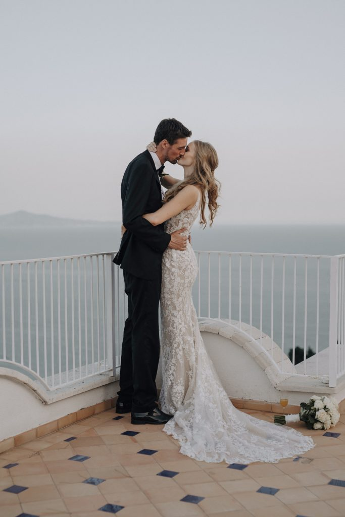 bride and groom on the rooftop of Villa Eva with the view of the Amalfi Coast